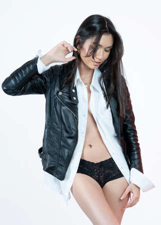 sensual woman wearing a leather jacket and underwear