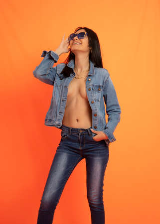 Smiling woman wearing jeans and glasses
