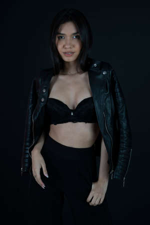 woman wearing black bra and leather jacket