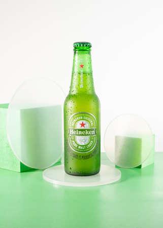 Bottle of Heineken Beer on green background