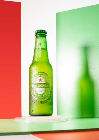 Cold bottle of Heineken Beer with a creative background