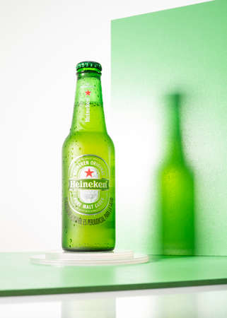 Cold bottle of Heineken Lager Beer with a creative background