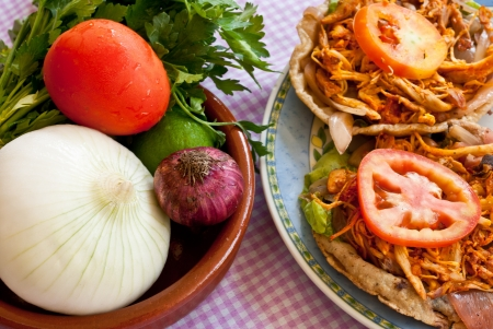 Salbutes are delicious little snacks which typify Mayan and Yucatecan cooking Stock Photo