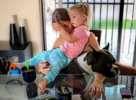 chaos: Monday morning Chaos: holding a child and a dog while trying to answer the phone and serve breakfast