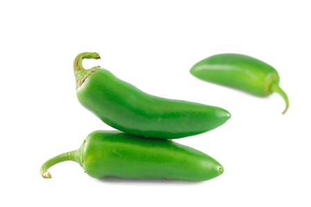 Fresh jalapeno peppers isolated on white background photo