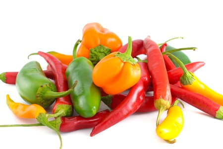 mexican background: A bunch of fresh peppers, including jalapeno,bell and serrano