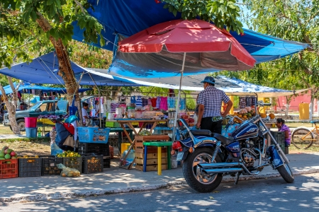 Yucatan, Mexico - March 30, 2013: A Woman selling fruits on a typical rural Yucatan Street Market