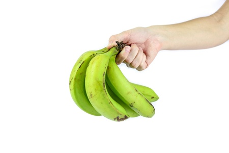 Hand holding some nutrient rich bananas photo
