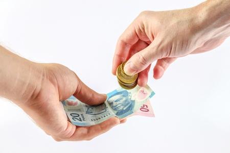 現金を与える手 写真素材