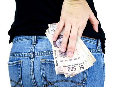 女性の背中のポケットにお金のスタックのバックミラー 写真素材