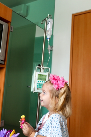 Recovering Little baby girl hospitalized with a Intravenous bag on a pole  Real situation Stock Photo