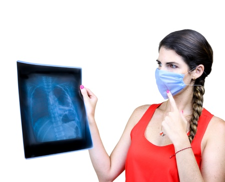 Female Medical student  examining an x-ray image