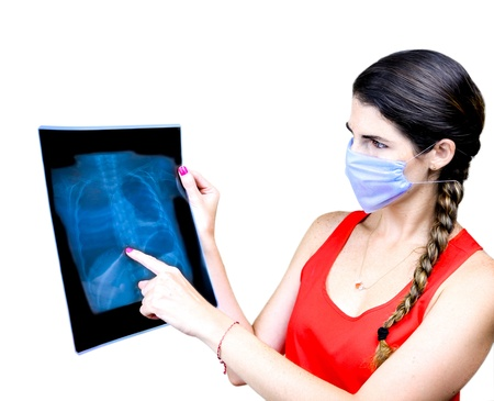 Female Medical Student  examining an x-ray image photo