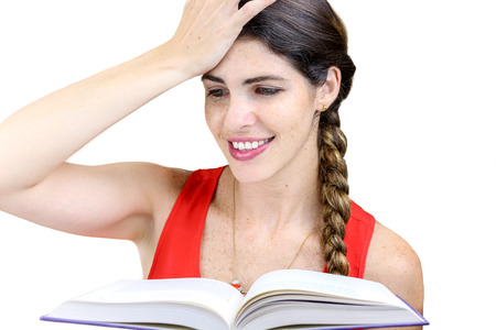 knew: Close up shot of a smiling, young woman reading her book Stock Photo