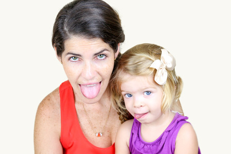 Mother And Daughter Making Silly Faces with tongue out Stock fotó