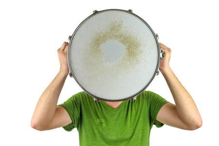 Drum Head  Man holding a snare drum over his head isolated on a white background
