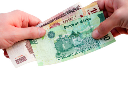 pesos: hands exchanging  cash Stock Photo