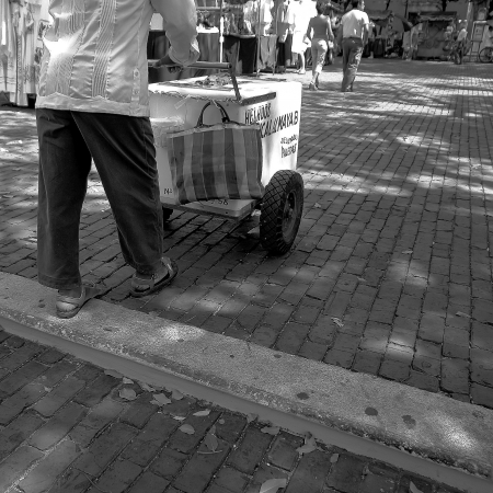 safest: MERIDA,YUCATAN,MEXICO - FEBRUARY 17  An unidentified man sells snacks in a Yucatan street  Yucatan is the safest State in Mexico and Merida was awarded City of Peace in 2011
