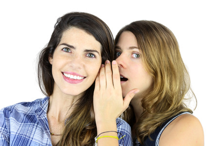 A couple  of beautiful young Women  gossiping photo