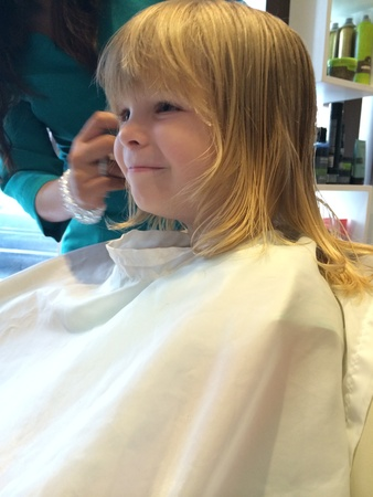 haircut: Cute child getting a haircut