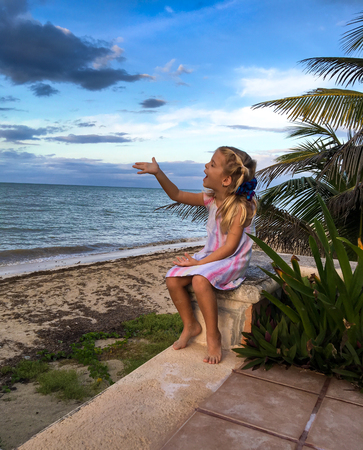 yucatan: Little Girl playing at a yucatan peninsula beach Stock Photo