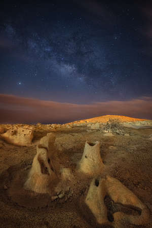 night view of a mountain and the milky way photography long exposure
