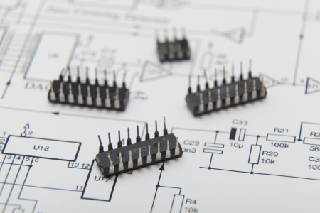 Microchip on one electronic diagram Stock Photo - 15882246