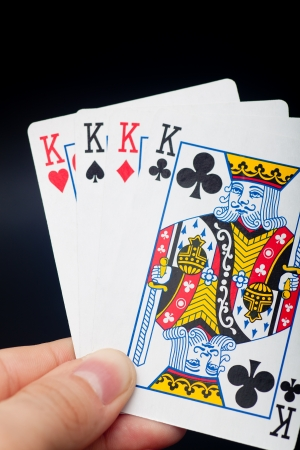pastimes: Group of cards in black background Editorial