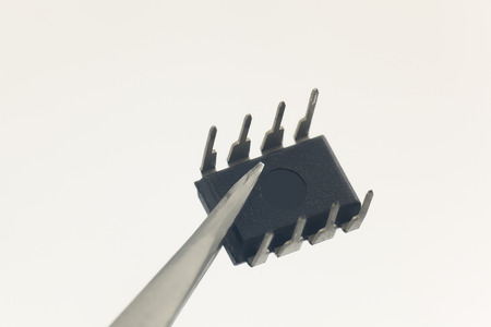 ttl: Integrated Circuit in white background Stock Photo