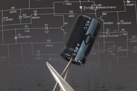 dielectric: Electronic capacitor in black background