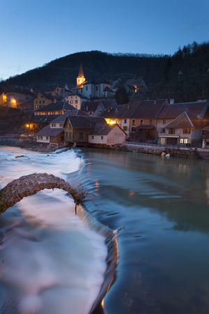 NIghtfall in Lods, Doubs,  Bourgogne-Franche-Comte, France Stock Photo