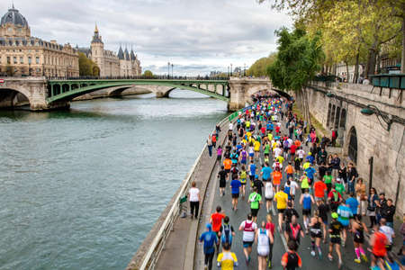 Marathon runners by the riverside in Paris