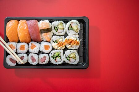 Japanese food. Sushi set on red background. Top view. Copy space 스톡 콘텐츠