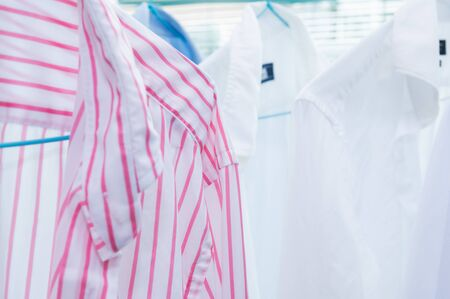 Shirts drying after ecological washing in professional laundry 스톡 콘텐츠
