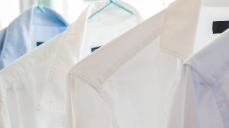White and blue shirts at a dry cleaners