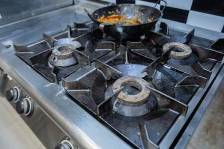 Stove off in a kitchen with a pan of rice 스톡 콘텐츠