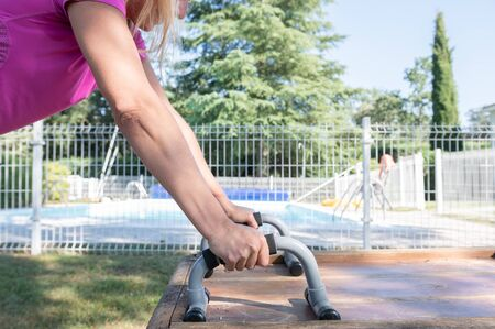 Woman working out in her garden on a summer day