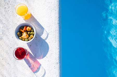 Drinks and snacks by the pool.Top view.Copy space. Relax and resting time in summertime