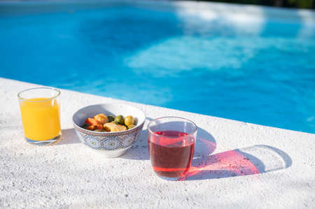 Drinks and snacks by the pool.Copy space. Summertime and vacations concept.