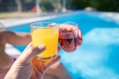 Toasting with colorful drinks by the pool.Enjoying life with you.