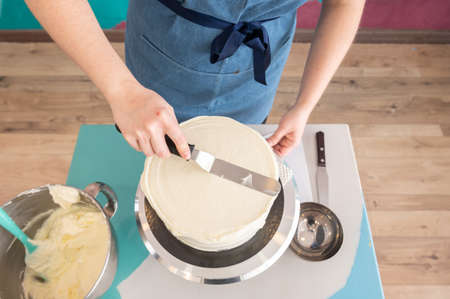 Pastry woman preparing a delicious cake.Top view. Celebration day concept Stock Photo