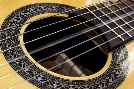 Close up on a vibrating string of a guitar Stock Photo