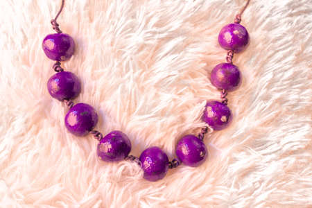 purple necklace on white hair background