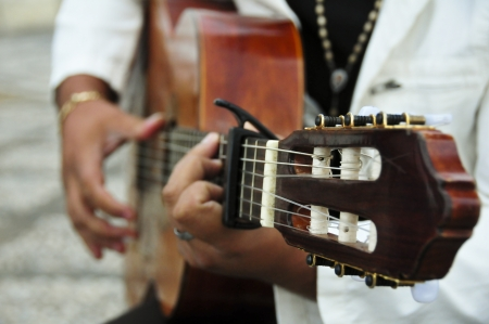 guitar player: Man playing the Spanish guitar