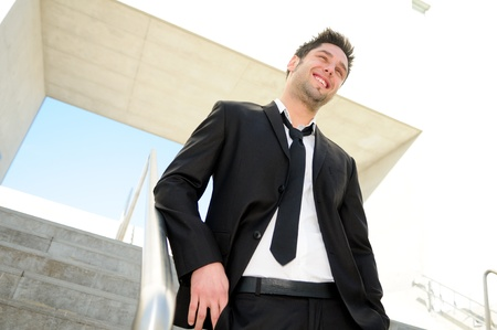 Portrait of a handsome young businessman smiling photo