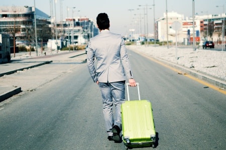 Man dressed in suit and suitcase in the street Stock Photo - 16271905