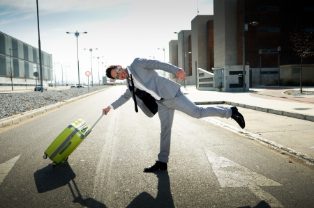 Funny man dressed in suit with a suitcase Stock Photo