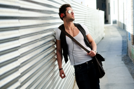 Portrait of young happy man in urban background Stock Photo - 16271664