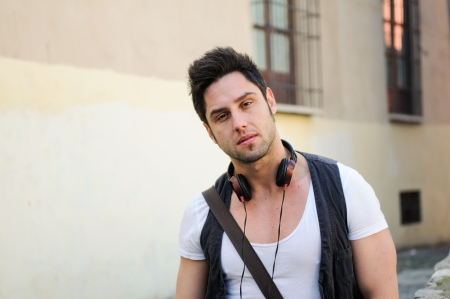 Portrait of young attractive man in urban background Stock Photo - 16271598