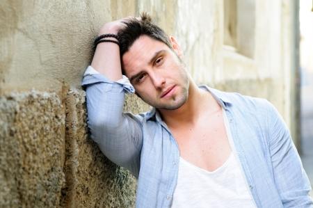 Portrait of handsome man in urban background  photo